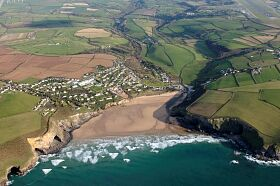 MAWGAN PORTH: Taken from NW with Mawgan Porth settlement with Gluvian in background.  © Cornwall Council