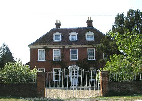 Photograph of the 18th century brick hall from the road.
