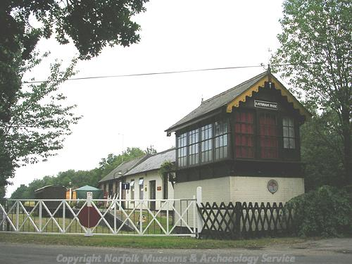 The 19th century station at Raynham Park. A signal box can be seen in the foreground.