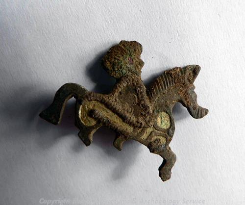 Roman horse and rider brooch from site of Roman settlement and temple