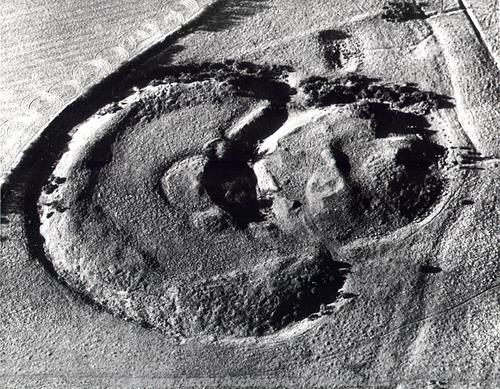 Aerial view of Horsford Castle. Horsford Castle from the air showing the bailey and the motte around the keep. There may have been a fortified barbican between the bailey and motte.