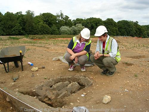 The excavation of a Roman kiln in Watlington. NHE volunteers inspect the excavation.