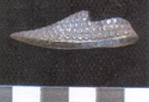 Post medieval toy silver shoe found by a metal detectorist.