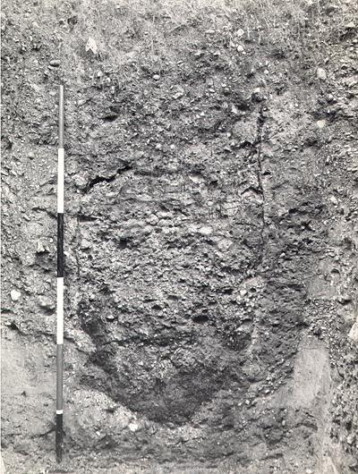 a section through one of the postholes in the centre of Arminghall Henge