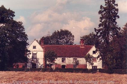 Shimpling Place, an Elizabethan or Jacobean house in Burston with Shimpling. The house is partly timber framed and has stepped gables.