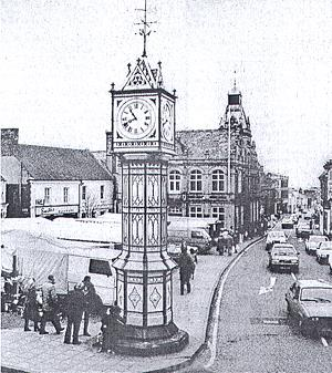 Photograph of Downham Market's famous clock tower. This cast iron octagonal clock tower has four clock faces and a pyramidal top. It was made in 1878 by W. Cunliffe in London
