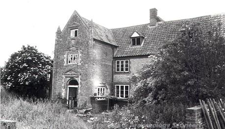 Photograph of Old Hall, Edgefield taken from the west. the photograph shows the porch tower that was added around 1600 to an existing flint building built in the 15th or 16th century.