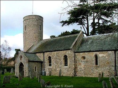 Photograph of St Andrew's Church, Framingham Earl. A medieval parish church, built mainly of flint with a 12th century round tower, a 13th century porch and extensive 19th century restoration. Photograph from www.norfolkchurches.co.uk