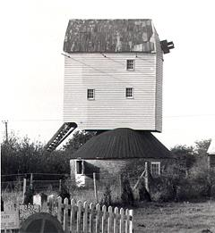 Photograph of a mid 18th century post mill in Garboldisham. The mill is now missing its sails.
