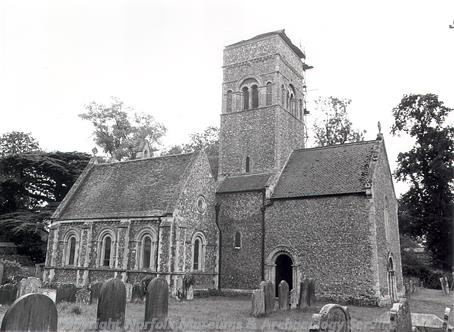 Photograph of St Mary's Church, Gillingham. This unusual Norman church may have been built in two different periods. It has an porch-like structure (narthex) west of the off centre tower and a nave and apsed chancel