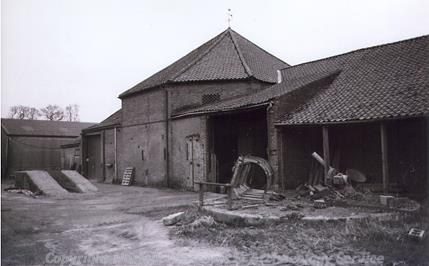 Photograph of the exterior of Octagon Barn, an octagonal engine shed in the grounds of Manor Farm, Little Plumstead.