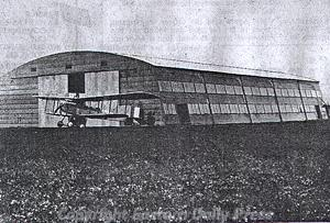 Photograph of a World War One hanger in Hellesdon. This large wooden hanger was constructed on the Mann Egerton site in 1916. The company