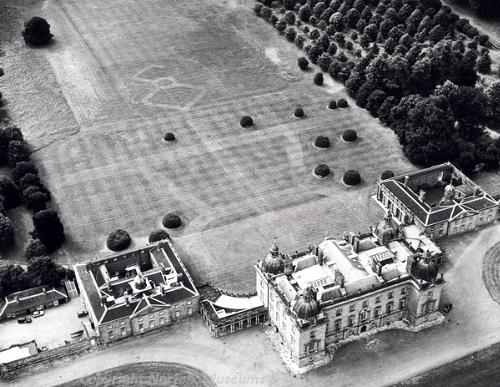 Houghton Hall and surrounding park. Parchmarks of the former garden lay out can be clearly seen behind the hall