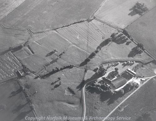 Aerial photograph of Babingley deserted medieval village earthworks. medieval ridge and furrow can be seen to the right of the photo.