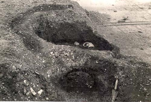 Photograph of the excavation of a Roman pottery kiln at Needham.