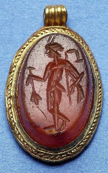 Photograph of a Roman intaglio remounted in the Early Saxon period and made into a pendant. The pendant was found on the site of Harford Park and Ride. Photograph from MODES.