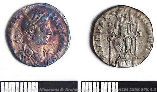 Photograph of a Roman silver siliqua coin from a 4th century AD hoard found at Carleton St Peter. Photograph from MODES.