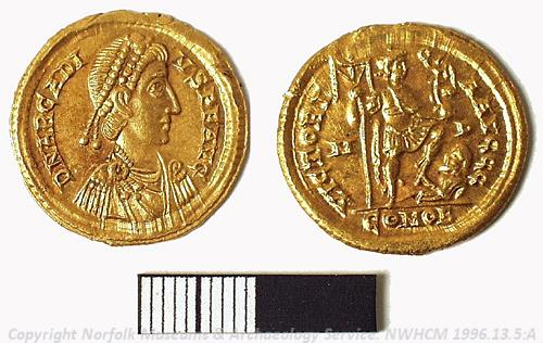 Photograph of a gold solidus from a hoard of Roman coins found at Deopham. Photograph from MODES.