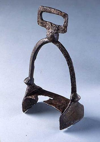 An iron and inlaid brass stirrup from the River Thet in Kilverstone. The stirrup may date to the Roman, Late Saxon or medieval period.