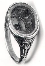 photograph of a Roman gold finger ring set with a cornelian intaglio depicting a portrait bust from Brancaster Roman fort.
