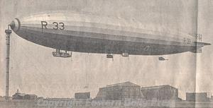 Photograph of a 'Pulham Pig', an airship, at her mooring mast at Pulham airfield. Photograph from Eastern Daily Press.