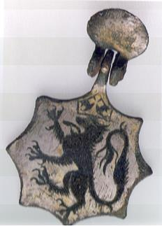 Photograph of a medieval horse harness pendant from Beeston Regis bearing the arms of Morley, of Norfolk.