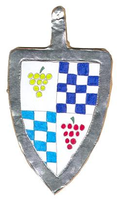 Photograph of a shield-shaped horse harness pendant made by Megan Dennis.