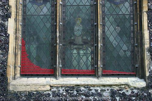 Photograph of a window in St John the Baptist Church, Maddermarket, Norwich dressed for the installation performance Rubia Rubia by Pat Derrick.