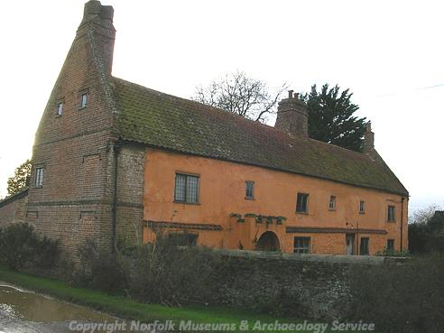 Photograph of Manor Farm House, a complex timber framed building.