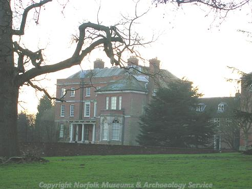 Photograph of Earsham Hall, an 18th century red brick construction designed by John Buxton.