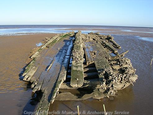 Photograph of a post medieval wreck on Holme beach. It may be the remains of the Vicuna, an ice carrying ship that sank on 7 March 1883 on route to King's Lynn.