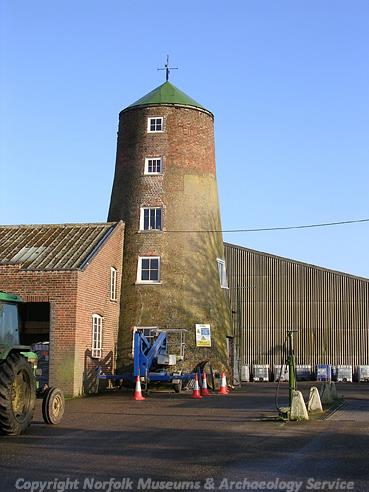 Photograph of Long Stratton windmill, a late 18th century brick tower mill.