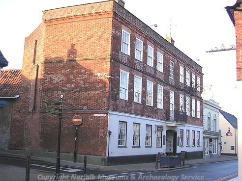 Photograph of The Swan Hotel, an undecorated 16th or 17th century timber framed inn.