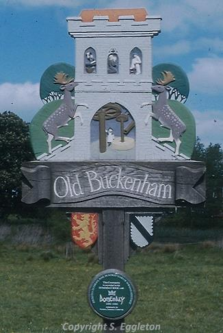 Photograph of Old Buckenham village sign by Steve Eggleton. The sign depicts Old Buckenham Castle.