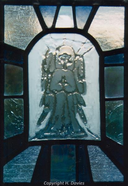 Photograph of fused stained glass by Hilary Davies inspired by Wickmere Church.
