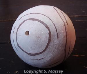Ceramic ball by Sarah Massey.