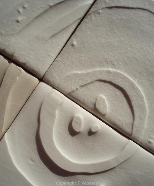 Detail of ceramic tile by Sarah Massey.