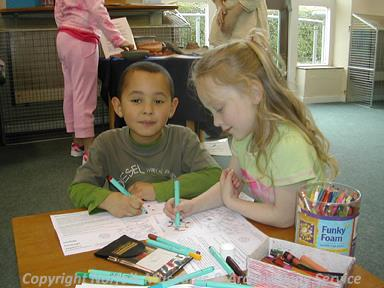 Photograph of children making Roman brooches at Attleborough Library Heritage Family Fun Day.