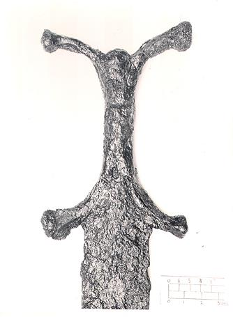 Photograph of the anthropoid handle of an Iron Age sword.
