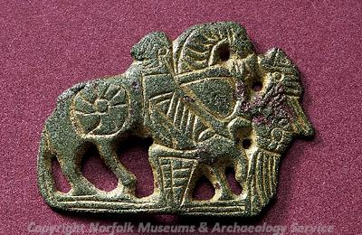 Photograph of a VIking, probably from a box, from Bylaugh. The mount depicts a valkyrie welcoming a warrior to Valhalla.