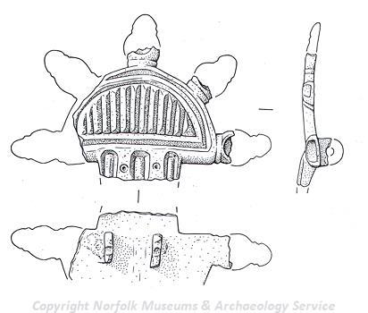 An Early Saxon radiate brooch.