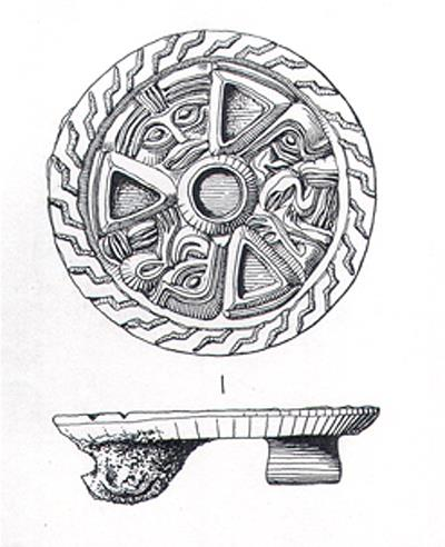 Early Saxon disc brooch with gilded animal and human mask decoration.