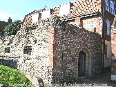 The entrance to the vaulted brick undercroft of the Guildhall, Blakeney