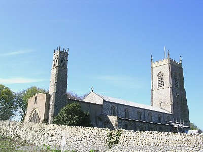 St Nicholas' Church, Blakeney, showing the two towers, the seven lancet east window and the clerestory.