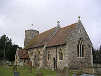 View of the chancel, showing the Late Saxon round tower and the south porch.