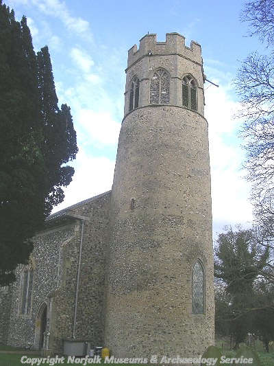 The 11th or 12th century round tower of St Mary's Church, with the 14th century belfry.