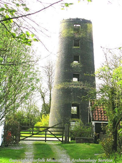 The six storey shell of a 19th century brick tower mill.
