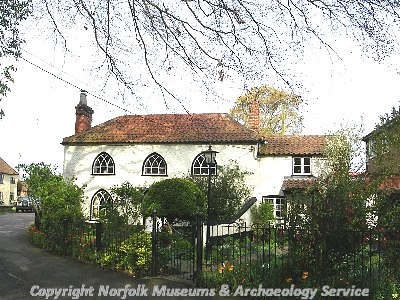 An 18th century Gothick cottage with showing the arched windows and Y-tracery.