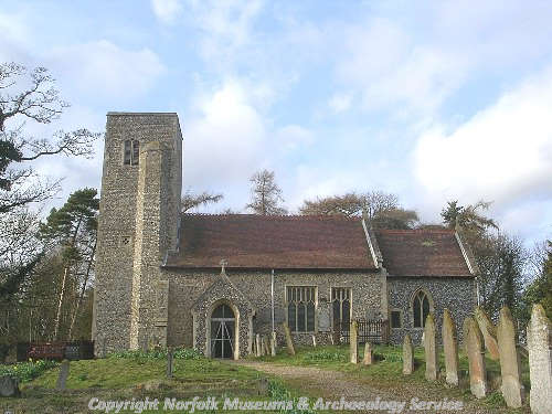 St Andrew's Church, Guist, from the south showing the west tower, the panel traceried late Perpendicular windows in the south nave and the south porch.