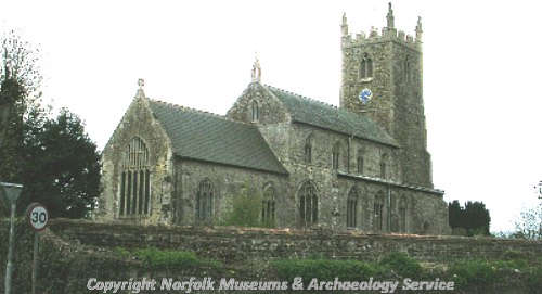 All Saints' Church showing the west tower, nave and chancel.